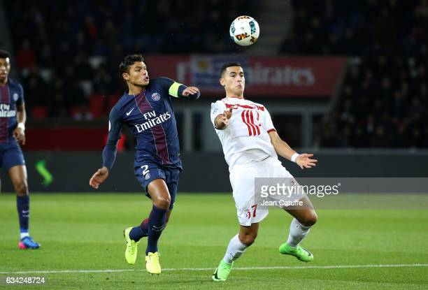 Thiago Silva of PSG and Anwar El Ghazi of Lille in action during the French Ligue 1 match between Paris SaintGermain and Lille OSC at Parc des...