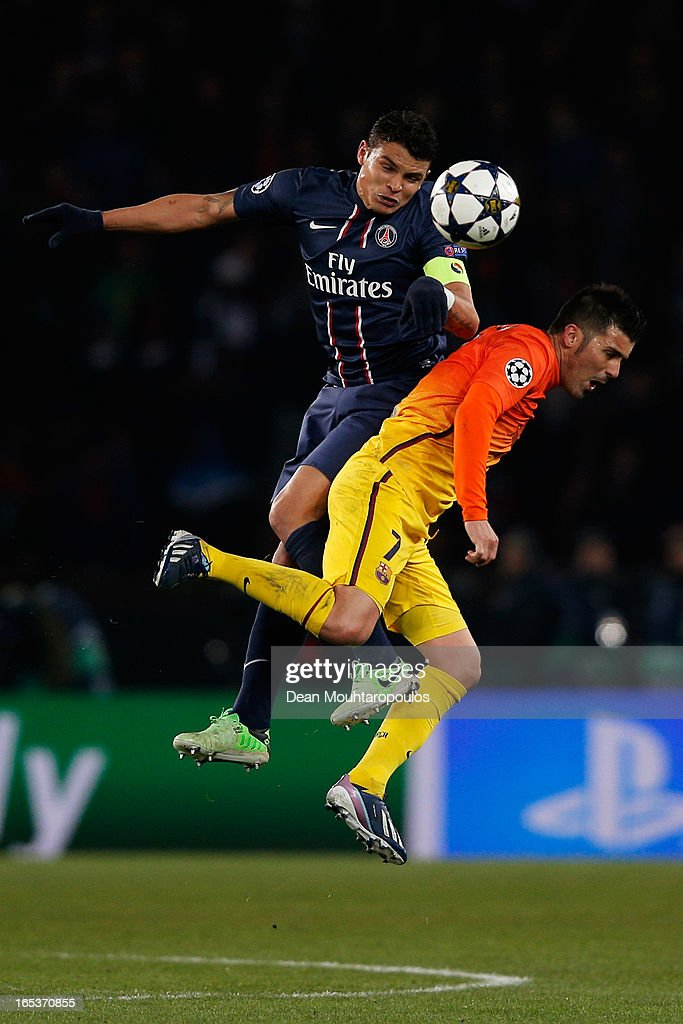 Thiago Silva of PSG and <a gi-track='captionPersonalityLinkClicked' href=/galleries/search?phrase=David+Villa&family=editorial&specificpeople=467566 ng-click='$event.stopPropagation()'>David Villa</a> of Barcelona battle for the header during the UEFA Champions League Quarter Final match between Paris Saint-Germain and Barcelona FCB at Parc des Princes on April 2, 2013 in Paris, France.