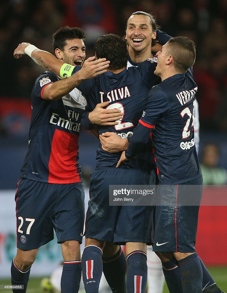 Thiago Silva of PSG celebrates his goal with teammates <a gi-track='captionPersonalityLinkClicked' href=/galleries/search?phrase=Javier+Pastore&family=editorial&specificpeople=5857872 ng-click='$event.stopPropagation()'>Javier Pastore</a>, <a gi-track='captionPersonalityLinkClicked' href=/galleries/search?phrase=Zlatan+Ibrahimovic&family=editorial&specificpeople=206139 ng-click='$event.stopPropagation()'>Zlatan Ibrahimovic</a>, <a gi-track='captionPersonalityLinkClicked' href=/galleries/search?phrase=Marco+Verratti&family=editorial&specificpeople=7256509 ng-click='$event.stopPropagation()'>Marco Verratti</a> during the french Ligue 1 match between Paris Saint-Germain FC and Olympique Lyonnais at the Parc des Princes stadium on December 1, 2013 in Paris, France.