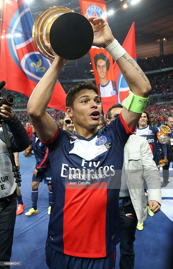 Thiago Silva of PSG celebrates the victory at the end of the French League Cup Final (finale de la Coupe de la Ligue) between Olympique Lyonnais OL and Paris Saint-Germain FC at Stade de France on April 19, 2014 in Saint Denis near Paris, France.