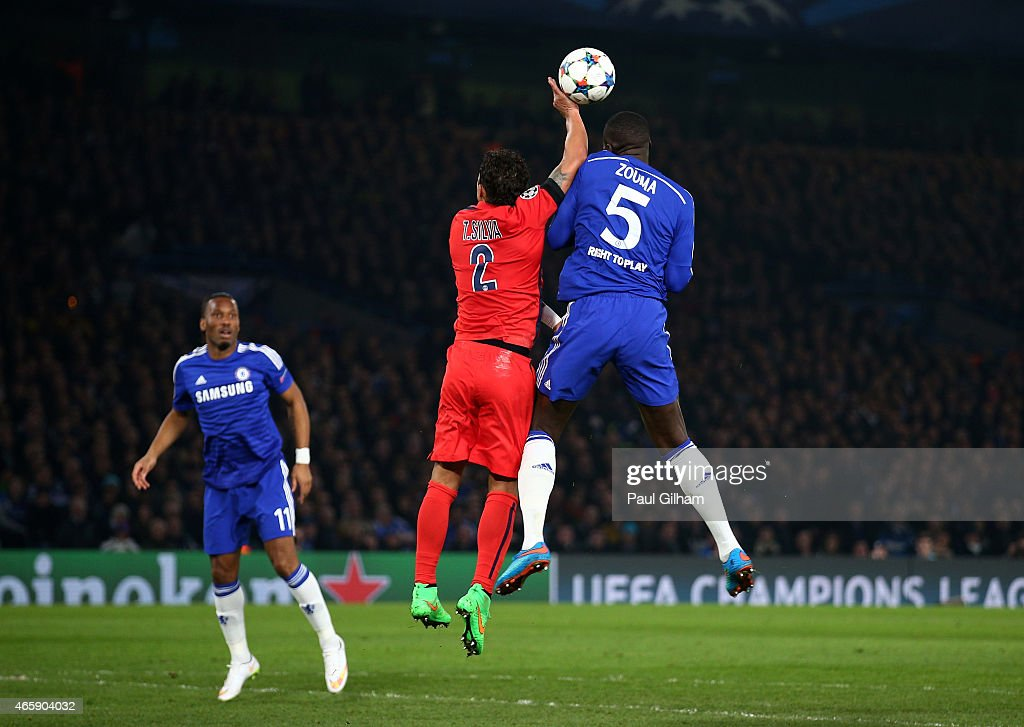 Thiago Silva of PSG handles the ball whilst jumping against Kurt Zouma of Chelsea to concede a penalty during the UEFA Champions League Round of 16, second leg match between Chelsea and Paris Saint-Germain at Stamford Bridge on March 11, 2015 in London, England.