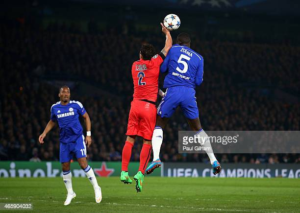 Thiago Silva of PSG handles the ball whilst jumping against Kurt Zouma of Chelsea to concede a penalty during the UEFA Champions League Round of 16...