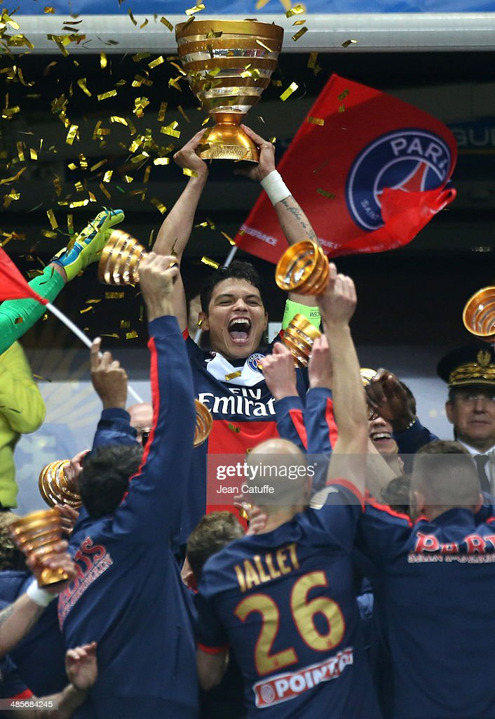 Thiago Silva of PSG holds the trophy and celebrates with his teammates the victory at the end of the French League Cup Final (finale de la Coupe de la Ligue) between Olympique Lyonnais OL and Paris Saint-Germain FC at Stade de France on April 19, 2014 in Saint Denis near Paris, France.