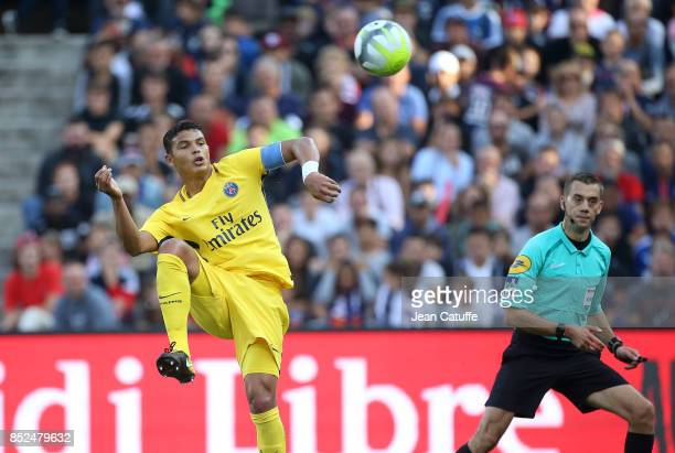 Thiago Silva of PSG in action while referee Clement Turpin looks on during the French Ligue 1 match between Montpellier Herault SC and Paris Saint...