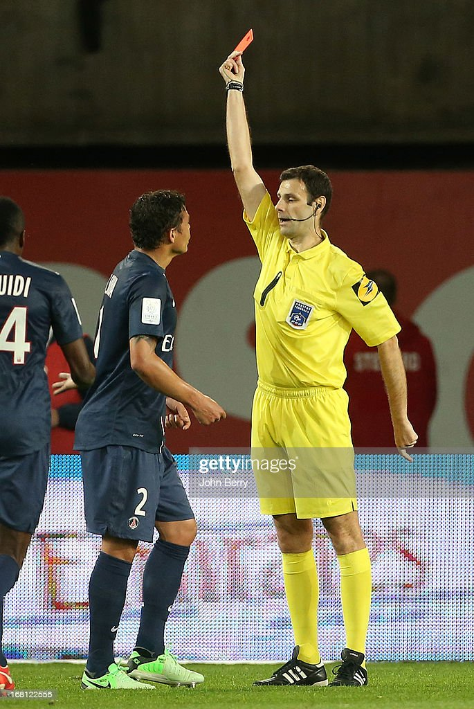 Thiago Silva of PSG receives a red card from referee Alexandre Castro during the Ligue 1 match between Paris Saint-Germain FC and Valenciennes FC at the Parc des Princes stadium on May 5, 2013 in Paris, France.