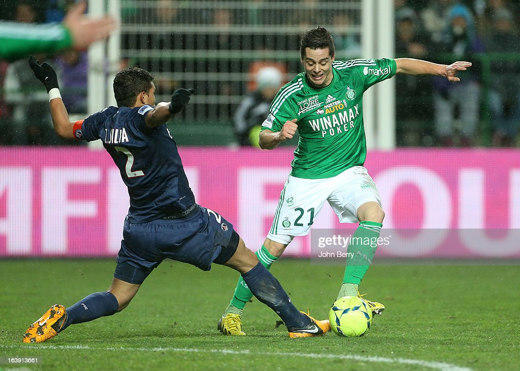 Thiago Silva of PSG tackles Romain Hamouma of Saint-Etienne during the Ligue 1 match between AS Saint-Etienne ASSE and Paris Saint-Germain FC at the Stade Geoffroy-Guichard on March 17, 2013 in Saint-Etienne, France.