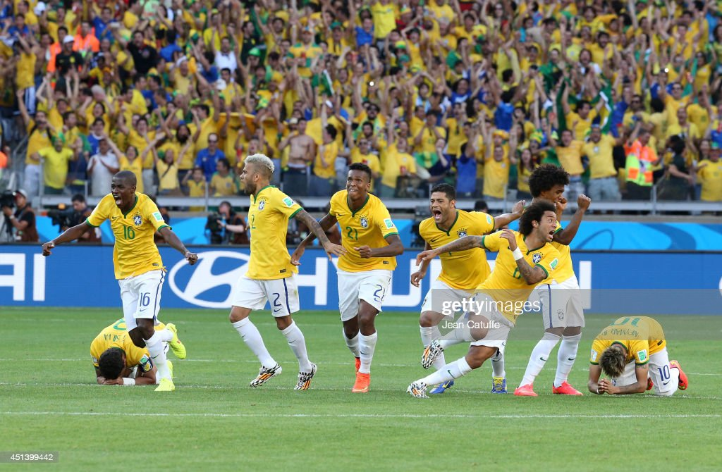 Thiago Silva, Ramires, <a gi-track='captionPersonalityLinkClicked' href=/galleries/search?phrase=Dani+Alves&family=editorial&specificpeople=2191863 ng-click='$event.stopPropagation()'>Dani Alves</a>, Jo, Marcelo, Hulk, <a gi-track='captionPersonalityLinkClicked' href=/galleries/search?phrase=Willian+-+Soccer+Player+for+Chelsea+and+Brazil&family=editorial&specificpeople=9886576 ng-click='$event.stopPropagation()'>Willian</a> and Neymar of Brazil celebrate the victory after the penalty shootout of the 2014 FIFA World Cup Brazil round of 16 match between Brazil and Chile at Estadio Mineirao on June 28, 2014 in Belo Horizonte, Brazil.