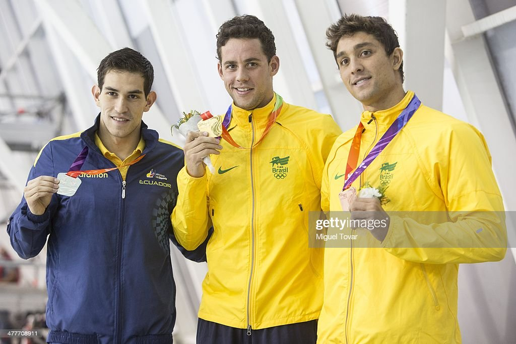 Thiago Teixeira of Brazil shows his gold medal with Esteban Enderica of Ecuador and Thiago Machado of Brazil in mens 400m individual medleyfinal event during day four of the X South American Games Santiago 2014 at Centro Acuatico Estadio Nacional on March 10, 2014 in Santiago, Chile.