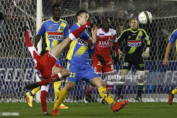 Thibault Peyre defender of Royal Excel Mouscron attempts a bicycle kick and hits Gilles Ruyssen defender of KVC Westerlo during the Jupiler Pro...