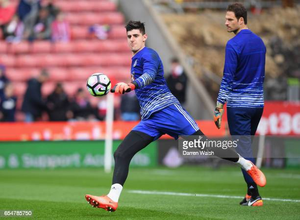 Thibaut Courtois and Asmir Begovic of Chelsea warm up prior to the Premier League match between Stoke City and Chelsea at Bet365 Stadium on March 18...