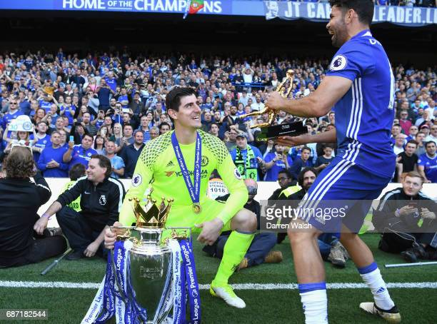 Thibaut Courtois and Diego Costa of Chelsea celebrate winning the league following the Premier League match between Chelsea and Sunderland at...