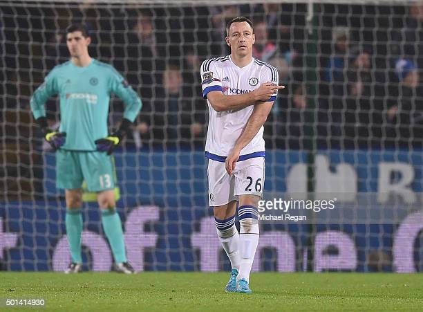 Thibaut Courtois and John Terry of Chelsea look dejected after the first goal during the Barclays Premier League match between Leicester City and...