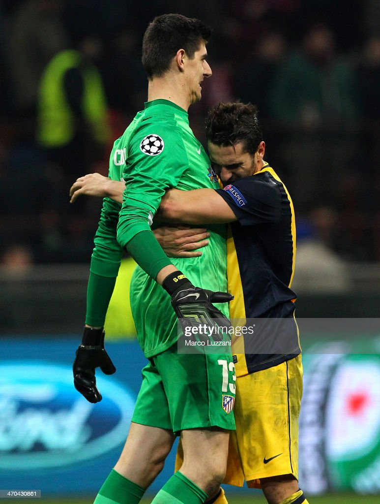 Thibaut Courtois (L) and Koke (R) of Club Atletico de Madrid celebrate the victory at the end of the UEFA Champions League Round of 16 match between AC Milan and Club Atletico de Madrid at Stadio Giuseppe Meazza on February 19, 2014 in Milan, Italy.