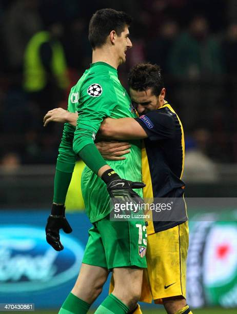 Thibaut Courtois and Koke of Club Atletico de Madrid celebrate the victory at the end of the UEFA Champions League Round of 16 match between AC Milan...