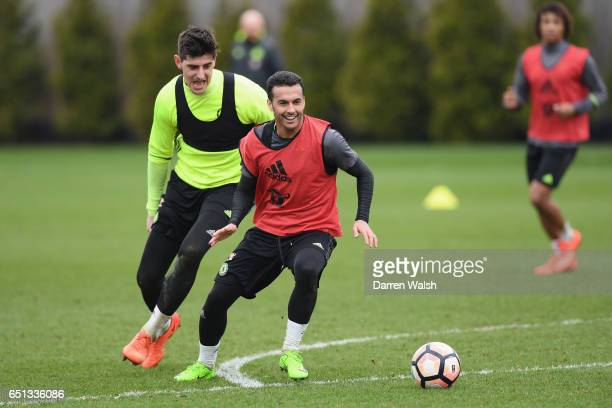 Thibaut Courtois and Pedro of Chelsea during a training session at Chelsea Training Ground on March 10 2017 in Cobham England