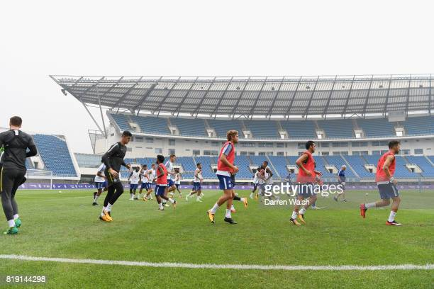 Thibaut Courtois Marcos Alonso Pedro and Cesc Fabregas of Chelsea during a training session at the AOTI Stadium on July 20 2017 in Beijing China