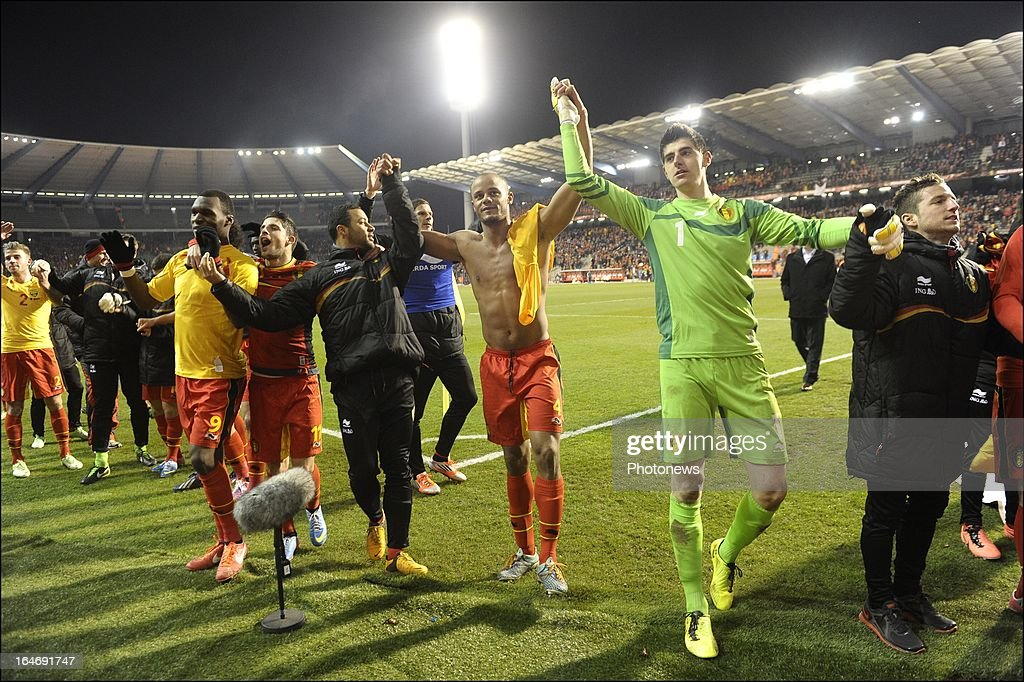 Thibaut Courtois of Belgium and Vincent Kompany (C) of Belgium celebrate their win with their team-mates after the FIFA 2014 World Cup Group A qualifying match between Belgium and Macedonia at the King Baudouin stadium on March 26, 2013 in Brussels, Belgium.