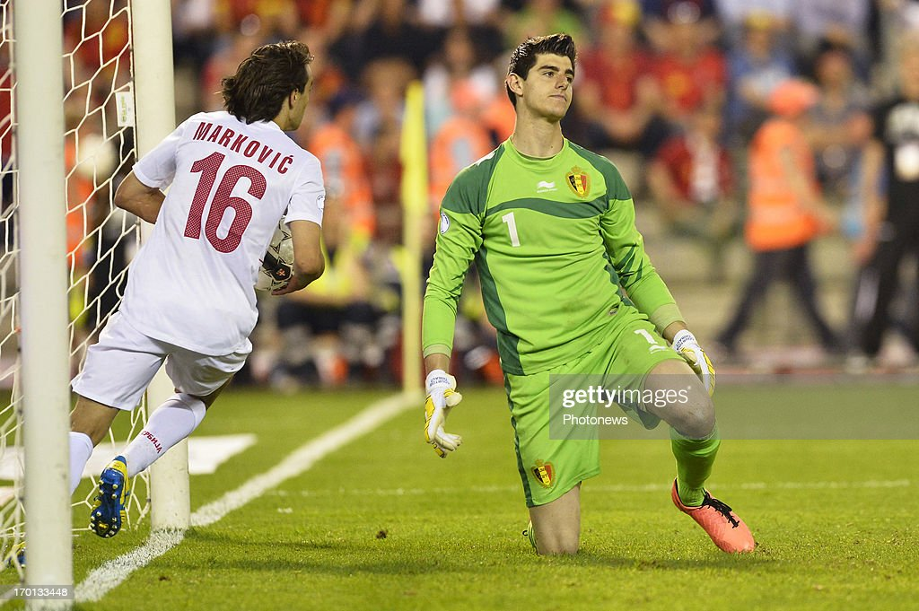 <a gi-track='captionPersonalityLinkClicked' href=/galleries/search?phrase=Thibaut+Courtois&family=editorial&specificpeople=7126410 ng-click='$event.stopPropagation()'>Thibaut Courtois</a> of Belgium looks dejected after conceding a goal during the FIFA 2014 World Cup Group A qualifying match between Belgium and Serbia at the King Baudouin stadium on June 07, 2013 in Brussels, Belgium.
