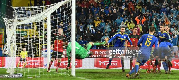 Thibaut Courtois of Belgium receives a goal during the FIFA World Cup 2018 qualification football match between Bosnia and Herzegovina and Belgium in...