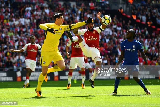 Thibaut Courtois of Chelsea and Alexandre Lacazette of Arsenal colide while both attempting to get to the ball during the The FA Community Shield...