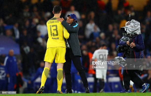 Thibaut Courtois of Chelsea and Antonio Conte Manager of Chelsea celebrate victory together after the UEFA Champions League Group C match between...