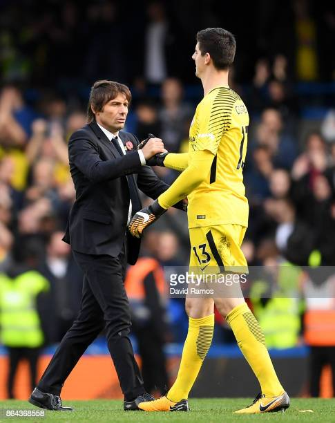 Thibaut Courtois of Chelsea and Antonio Conte Manager of Chelsea embrace after the Premier League match between Chelsea and Watford at Stamford...
