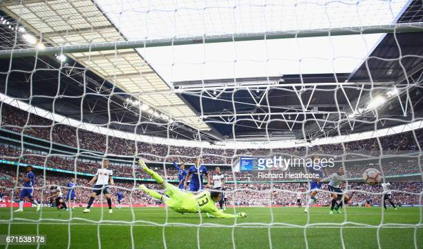 Thibaut Courtois of Chelsea attempts to save as Harry Kane of Tottenham Hotspur scores his sides first goal during The Emirates FA Cup SemiFinal...