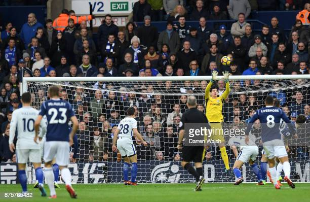 Thibaut Courtois of Chelsea catches a cross during the Premier League match between West Bromwich Albion and Chelsea at The Hawthorns on November 18...