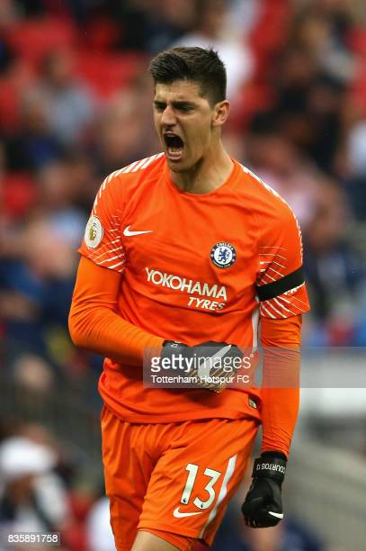 Thibaut Courtois of Chelsea celebrates after his side score their second goal during the Premier League match between Tottenham Hotspur and Chelsea...