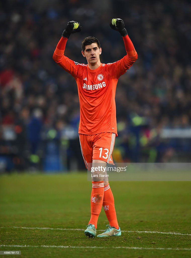 Thibaut Courtois of Chelsea celebrates as Didier Drogba of Chelsea (not pictured) scores their fourth goal during the UEFA Champions League Group G match between FC Schalke 04 and Chelsea FC at Veltins-Arena on November 25, 2014 in Gelsenkirchen, Germany.