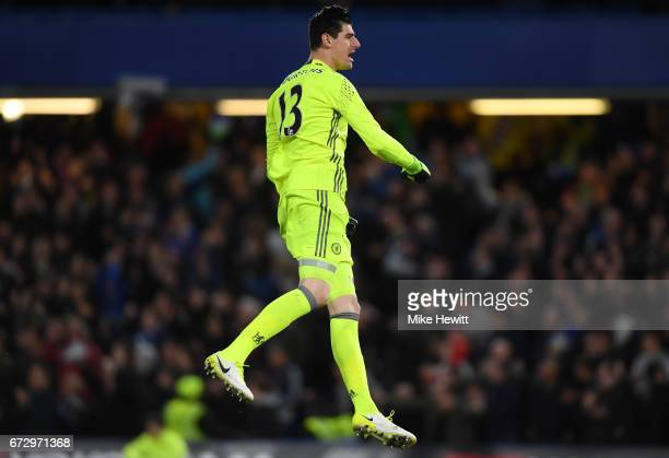 Thibaut Courtois of Chelsea celebrates as Diego Costa of Chelsea scores their third goal during the Premier League match between Chelsea and...