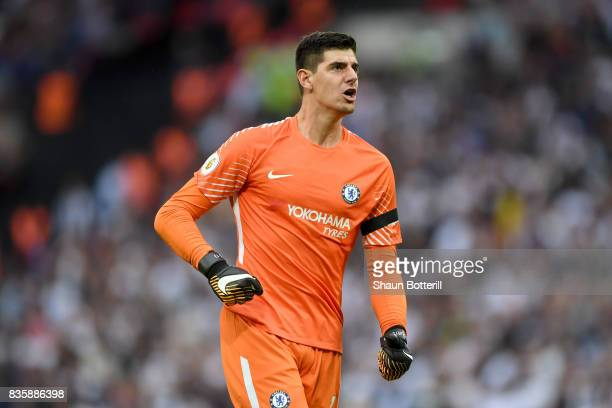 Thibaut Courtois of Chelsea celebrates his sides second goal during the Premier League match between Tottenham Hotspur and Chelsea at Wembley Stadium...