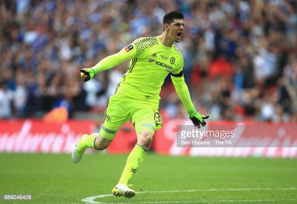 Thibaut Courtois of Chelsea celebrates his teams first goal during the Emirates FA Cup Final between Arsenal and Chelsea at Wembley Stadium on May 27...