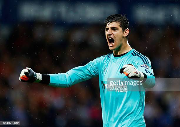 Thibaut Courtois of Chelsea celebrates the opening goal scored by Pedro of Chelsea during the Barclays Premier League match between West Bromwich...
