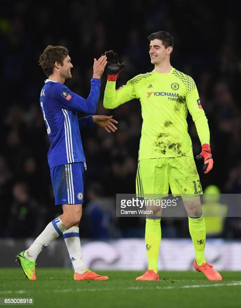 Thibaut Courtois of Chelsea celebrates victory with Marcos Alonso of Chelsea after The Emirates FA Cup QuarterFinal match between Chelsea and...