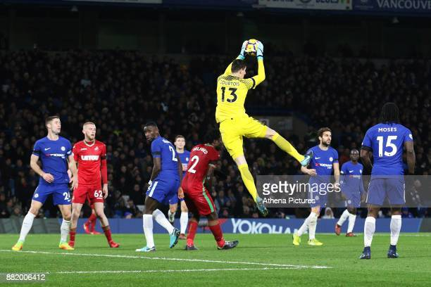 Thibaut Courtois of Chelsea claims the ball as Wilfried Bony of Swansea City falls short during the Premier League match between Chelsea and Swansea...