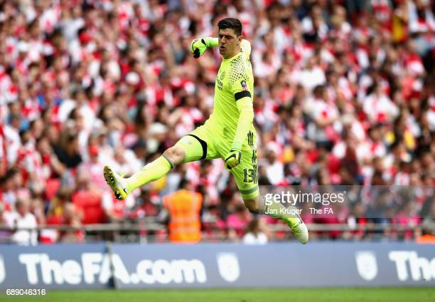 Thibaut Courtois of Chelsea clebrates his teams first goal during the Emirates FA Cup Final between Arsenal and Chelsea at Wembley Stadium on May 27...