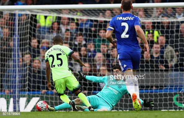 Thibaut Courtois of Chelsea fouls Fernandinho of Manchester City to conceed a penalty during the Barclays Premier League match between Chelsea and...