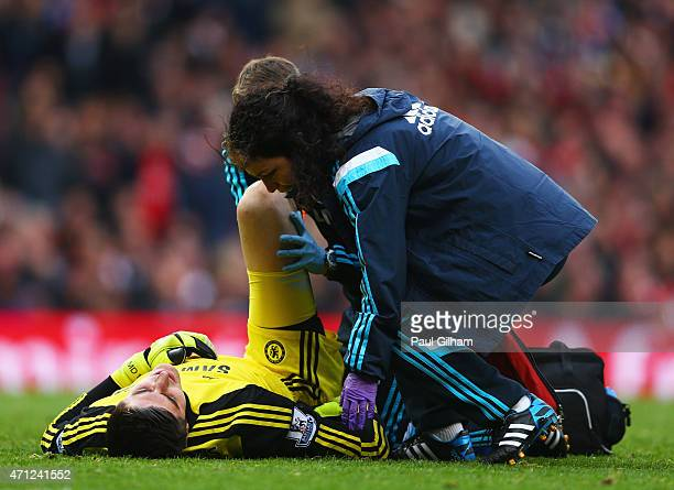Thibaut Courtois of Chelsea is given treatment by Eva Carneiro during the Barclays Premier League match between Arsenal and Chelsea at Emirates...