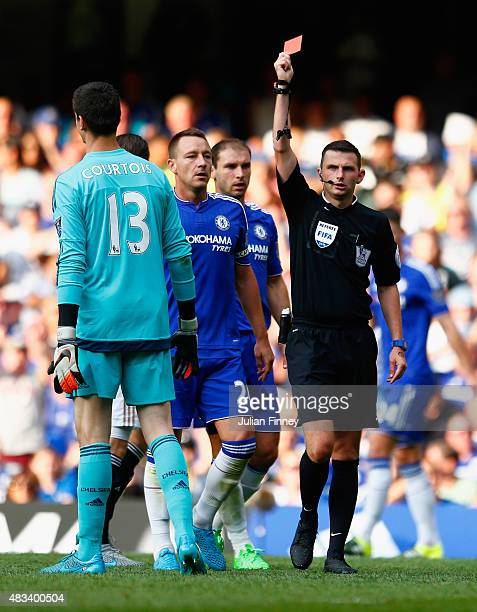 Thibaut Courtois of Chelsea is shown the red card by referee Michael Oliver during the Barclays Premier League match between Chelsea and Swansea City...