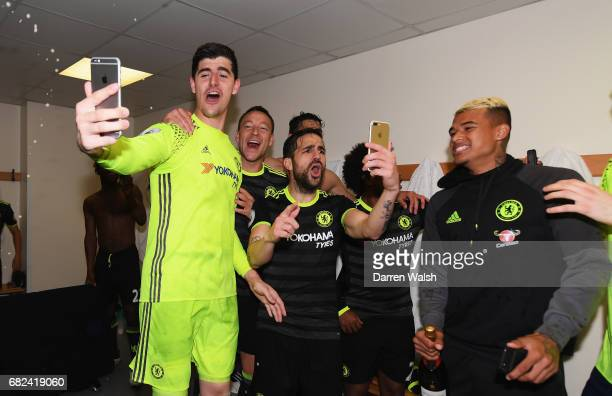 Thibaut Courtois of Chelsea John Terry of Chelsea and Cesc Fabregas of Chelsea celebrate winning the league in teh changing room after the Premier...