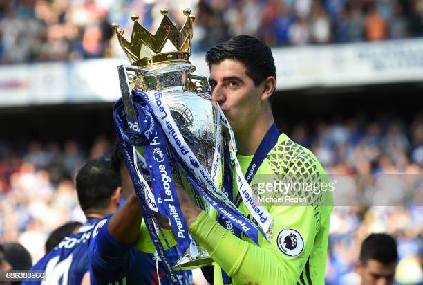 Thibaut Courtois of Chelsea kisses the Premier League Trophy after the Premier League match between Chelsea and Sunderland at Stamford Bridge on May...