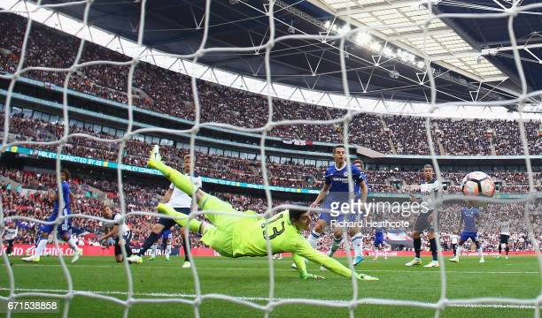 Thibaut Courtois of Chelsea looks back as Harry Kane of Tottenham Hotspur scores his sides first goal during The Emirates FA Cup SemiFinal between...