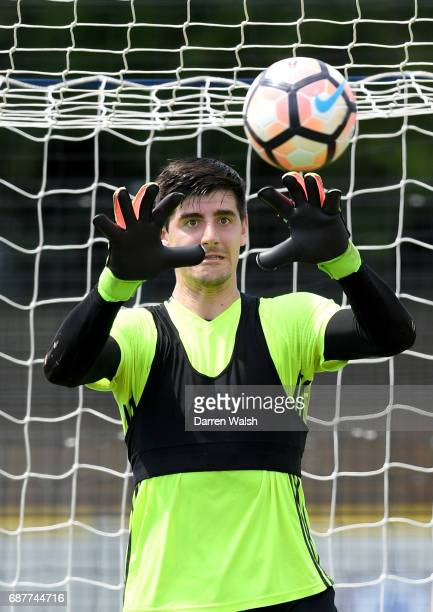 Thibaut Courtois of Chelsea makes a save during a Chelsea training session at Chelsea Training Ground on May 24 2017 in Cobham England