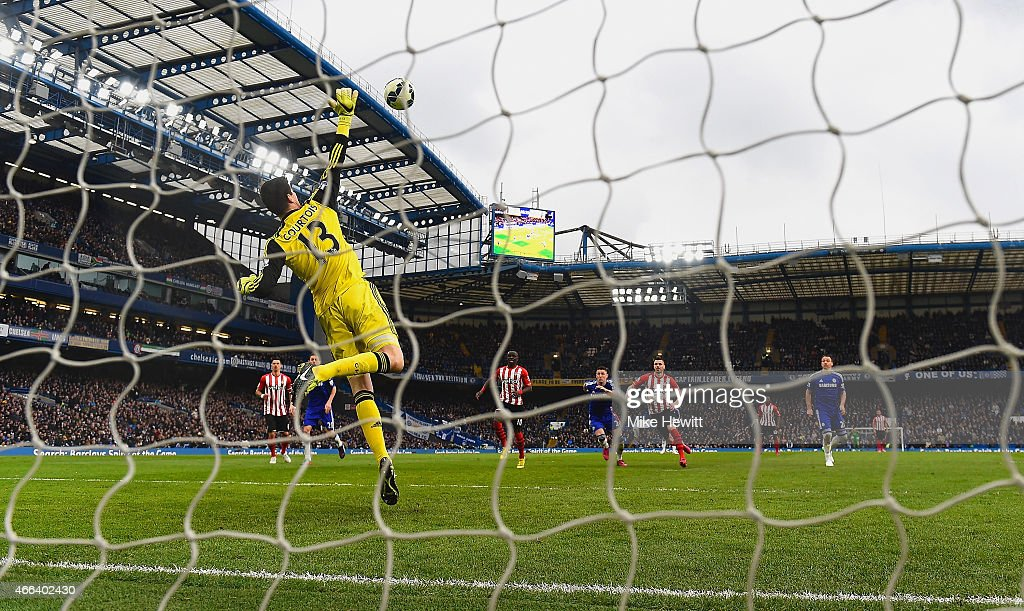 Thibaut Courtois of Chelsea makes a save during the Barclays Premier League match between Chelsea and Southampton at Stamford Bridge on March 15, 2015 in London, England.