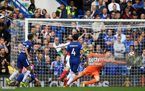 Thibaut Courtois of Chelsea makes a save during the Premier League match between Chelsea and Arsenal at Stamford Bridge on September 17 2017 in...
