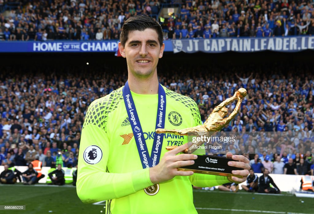 Thibaut Courtois of Chelsea poses with the Golden Glove award after the Premier League match between Chelsea and Sunderland at Stamford Bridge on May 21, 2017 in London, England.