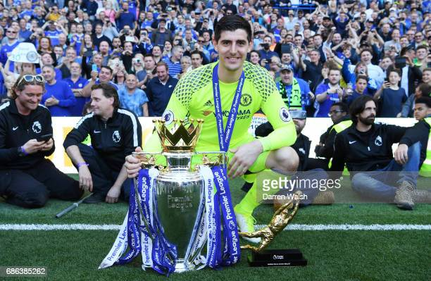 Thibaut Courtois of Chelsea poses with the Preimer League Trophy and the Golden Glove award after the Premier League match between Chelsea and...