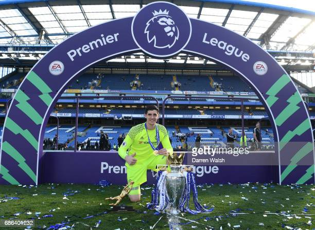 Thibaut Courtois of Chelsea poses with the Premier League Trophy and the Golden Glove after the Premier League match between Chelsea and Sunderland...