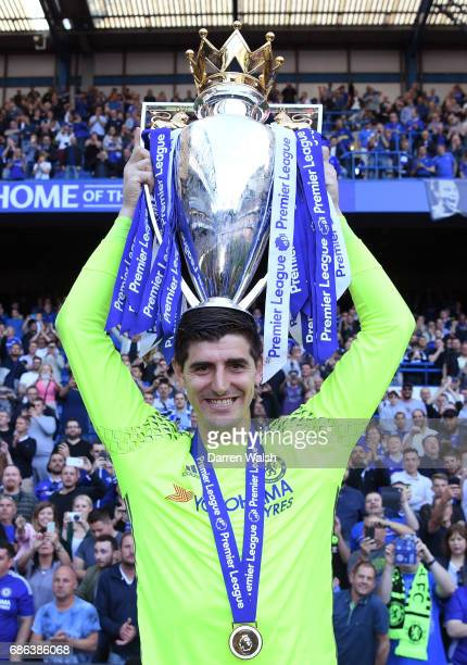 Thibaut Courtois of Chelsea poses with the Premier League Trophy after the Premier League match between Chelsea and Sunderland at Stamford Bridge on...